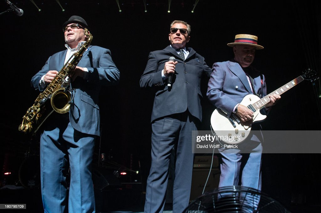 Lee Tompson, Graham McPherson and Chris Foreman from Madness perform at L'Olympia on September 16, 2013 in Paris, France.