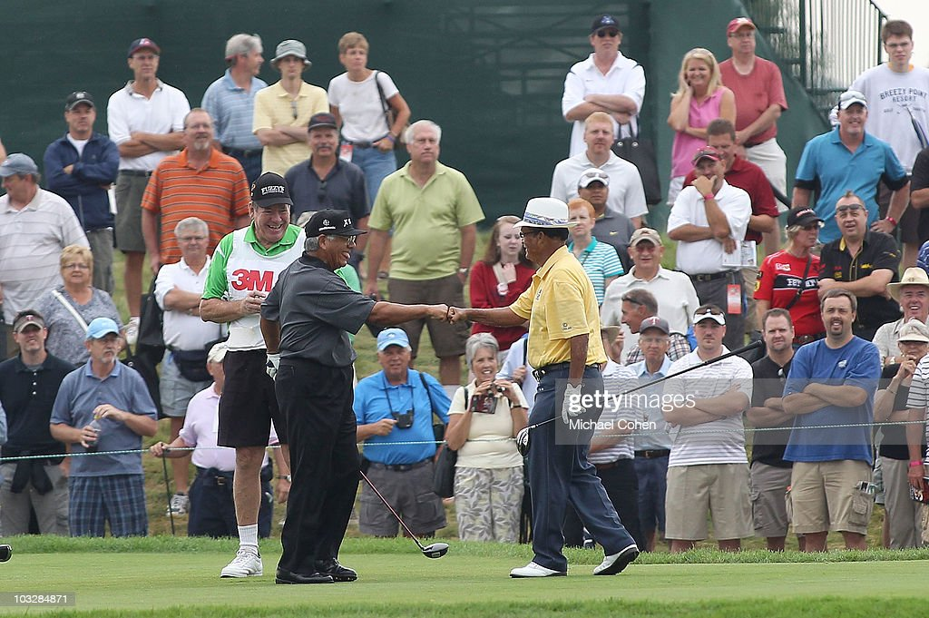 Lee Trevino (L) and Chi Chi Rodriguez celebrate on the first tee box during the Greats of Golf exhibition during the second round of the 3M Championship at TPC Twin Cities held on August 7, 2010 in Blaine, Minnesota.