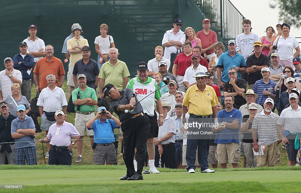 Lee Trevino (L) hits his drive on the first tee as Chi Chi Rodriguez (R) looks on during the Greats of Golf exhibition during the second round of the 3M Championship at TPC Twin Cities held on August 7, 2010 in Blaine, Minnesota.
