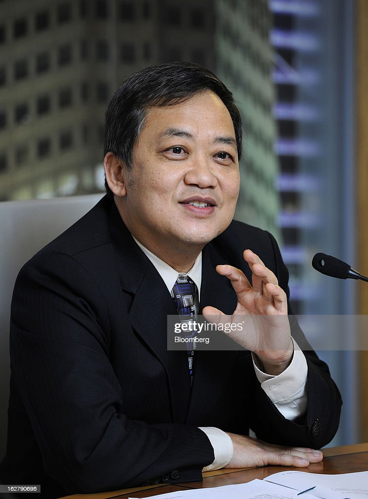 Lee Wai Fai, chief financial officer of United Overseas Bank Ltd. (UOB), gestures whilst speaking at a news conference in Singapore, on Wednesday, Feb. 27, 2013. United Overseas Bank Ltd., Southeast Asia's third-largest lender by assets, said profit rose for a fourth straight quarter on higher income from wealth management and capital markets. Photographer: Munshi Ahmed/Bloomberg via Getty Images
