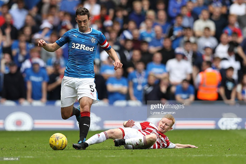 Lee Wallace of Rangers jumps over the tackle of Alister Crawford of Hamilton Academical during the Ladbrokes Scottish Premiership match between Rangers and Hamilton Academical at Ibrox Stadium on August 6, 2016 in Glasgow, Scotland.