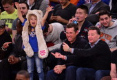 Lee Westwood and his daughter Poppy Westwood attend the Memphis Grizzlies vs New York Knicks game at Madison Square Garden on December 21 2013 in New...