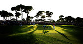 Lee Westwood and Ian Poulter of England putt out on the 18th green during the final round of the 2014 Turkish Airlines Open at The Montgomerie Maxx...