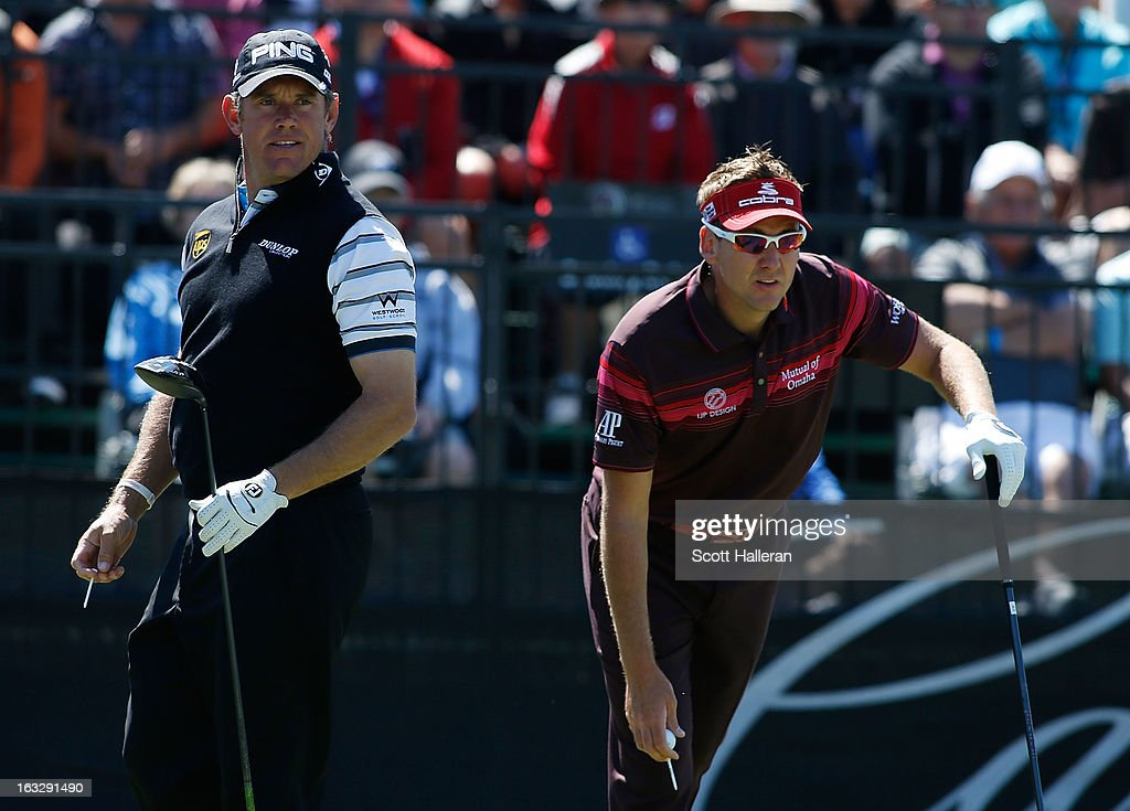Lee Westwood (L) and Ian Poulter of England wait on the tenth tee during the first round of the WGC-Cadillac Championship at the Trump Doral Golf Resort & Spa in Miami, Florida.
