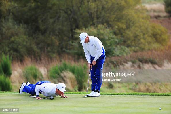 Lee Westwood and Jamie Donaldson of Europe line up a putt on the 9th hole during the Afternoon Foursomes of the 2014 Ryder Cup on the PGA Centenary...