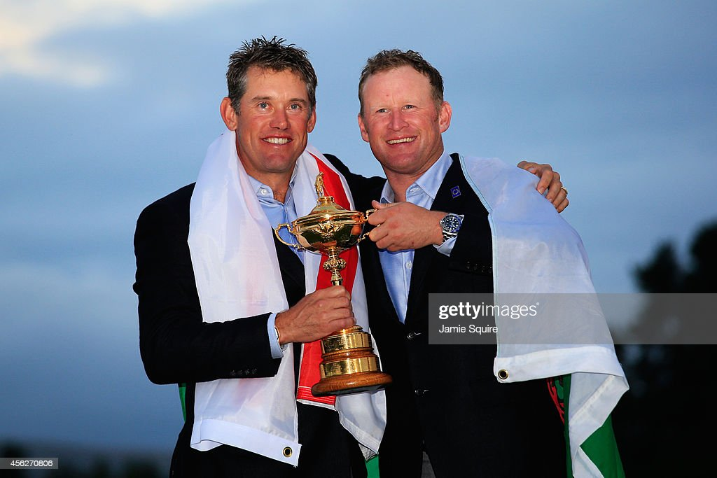 Lee Westwood and Jamie Donaldson of Europe pose with the Ryder Cup trophy after the Singles Matches of the 2014 Ryder Cup on the PGA Centenary course...