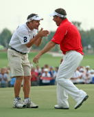 Lee Westwood of England abd his caddie Billy Foster celebrate after winning the Dubai World Championship and The Race to Dubai on the Earth Course...