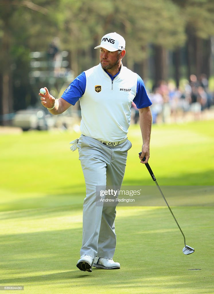 <a gi-track='captionPersonalityLinkClicked' href=/galleries/search?phrase=Lee+Westwood&family=editorial&specificpeople=171611 ng-click='$event.stopPropagation()'>Lee Westwood</a> of England acknowledges the crowd on the 13th green during day four of the BMW PGA Championship at Wentworth on May 29, 2016 in Virginia Water, England.