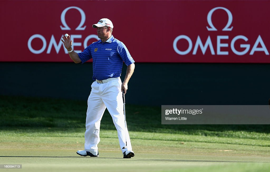 Lee Westwood of England acknowledges the crowd on the 17th green during the final round of the Omega Dubai Desert Classic at Emirates Golf Club on February 3, 2013 in Dubai, United Arab Emirates.