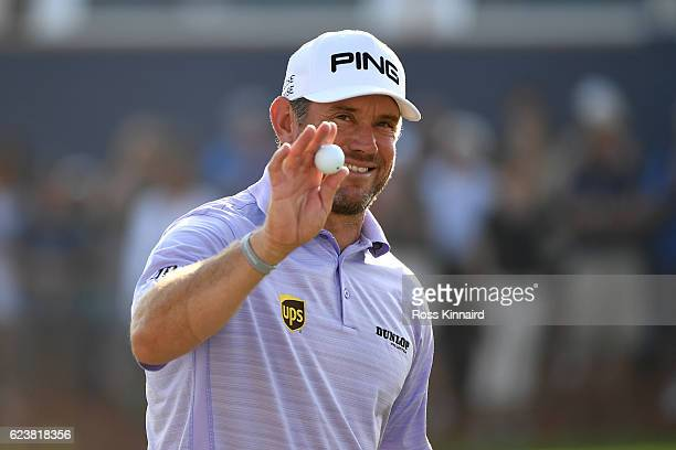 Lee Westwood of England acknowledges the crowd on the 18th green during day one of the DP World Tour Championship at Jumeirah Golf Estates on...