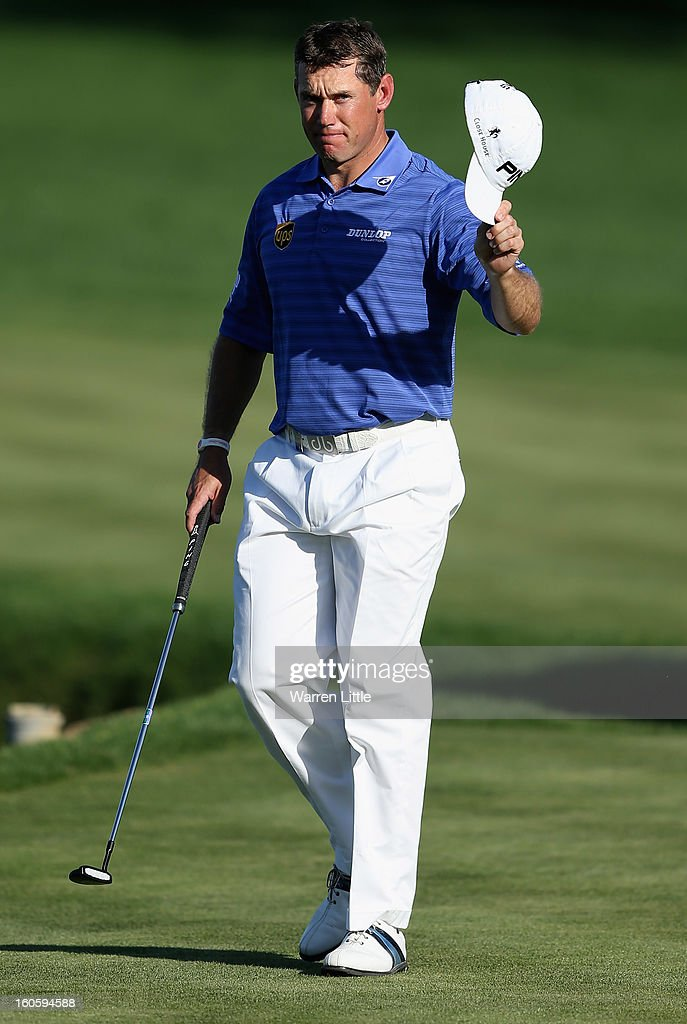 Lee Westwood of England acknowledges the crowd on the 18th green during the final round of the Omega Dubai Desert Classic at Emirates Golf Club on February 3, 2013 in Dubai, United Arab Emirates.