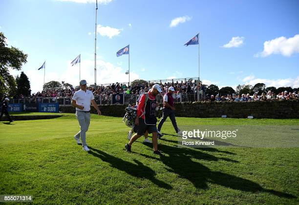 Lee Westwood of England Alex Noren of Sweden and Sergio Garcia of Spain walk down the first hole during day one of the British Masters at Close House...