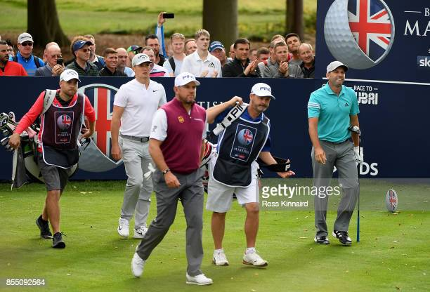 Lee Westwood of England Alex Noren of Sweden and Sergio Garcia of Spain walk down the 6th hole during day one of the British Masters at Close House...