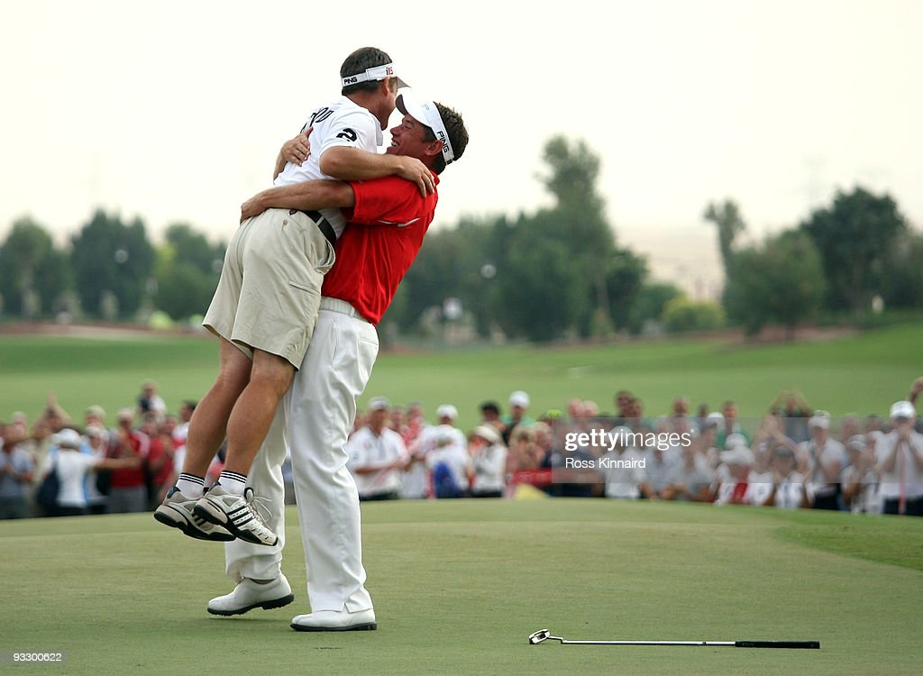Lee Westwood of England and his caddie Billy Foster celebrate after winning the Dubai World Championship and The Race to Dubai on the Earth Course...