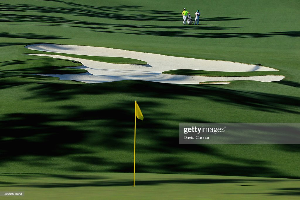 <a gi-track='captionPersonalityLinkClicked' href=/galleries/search?phrase=Lee+Westwood&family=editorial&specificpeople=171611 ng-click='$event.stopPropagation()'>Lee Westwood</a> of England and his caddie Billy Foster stand on the fairway of the 10th hole during the first round of the 2014 Masters Tournament at Augusta National Golf Club on April 10, 2014 in Augusta, Georgia.