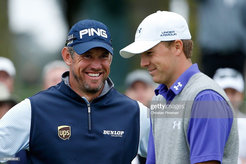 Lee Westwood of England and Jordan Spieth laugh on the 17th tee box during round three of the World Golf Championships Cadillac Match Play at TPC Harding Park on May 1, 2015 in San Francisco, California.