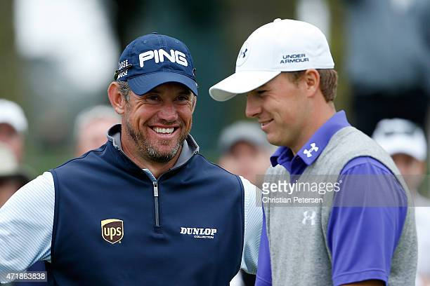 Lee Westwood of England and Jordan Spieth laugh on the 17th tee box during round three of the World Golf Championships Cadillac Match Play at TPC...