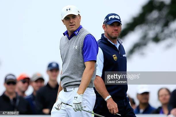 Lee Westwood of England and Jordan Spieth stand on the second hole tee box during round three of the World Golf Championships Cadillac Match Play at...