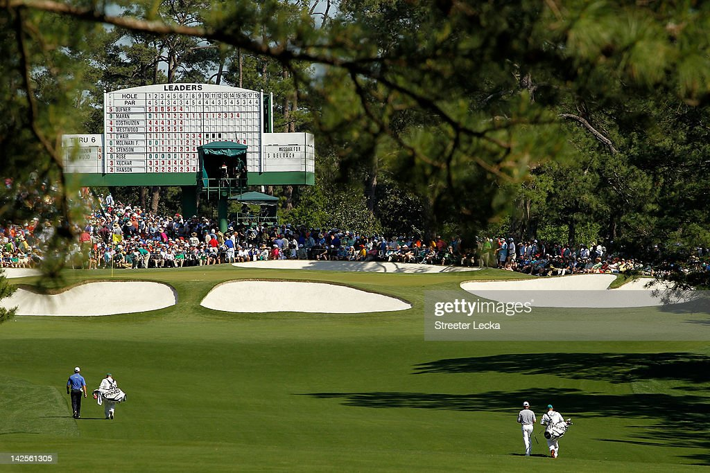 Lee Westwood of England and Louis Oosthuizen of South Africa walk up the seventh fairway during the third round of the 2012 Masters Tournament at...
