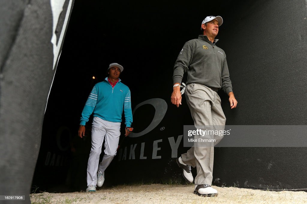 Lee Westwood of England and Rickie Fowler walk to the 17th tee during the second round of the Honda Classic at PGA National Resort and Spa on March 1, 2013 in Palm Beach Gardens, Florida.