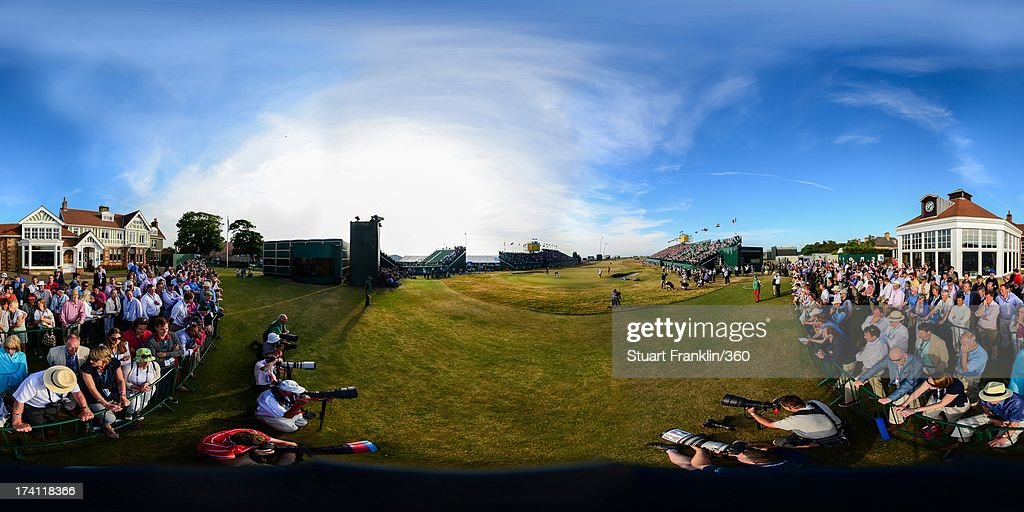 Lee Westwood of England and Tiger Woods of the United States putt on the 18th green as galleries of spectators look on during the third round of the 142nd Open Championship at Muirfield on July 20, 2013 in Gullane, Scotland.