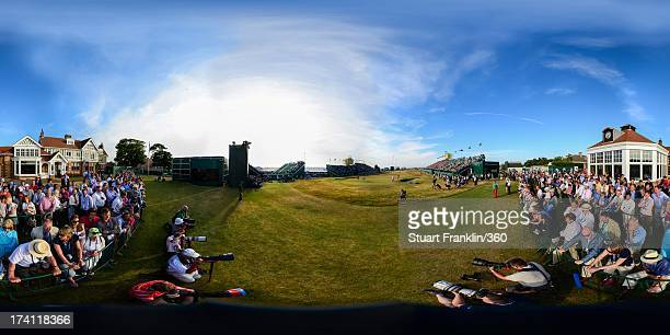 Lee Westwood of England and Tiger Woods of the United States putt on the 18th green as galleries of spectators look on during the third round of the...