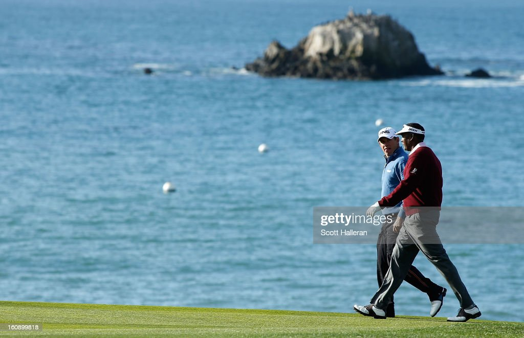 Lee Westwood of England (L) and Vijay Singh of Fiji walk on the fourth hole during the first round of the AT&T Pebble Beach National Pro-Am at Pebble Beach Golf Links on February 7, 2013 in Pebble Beach, California.