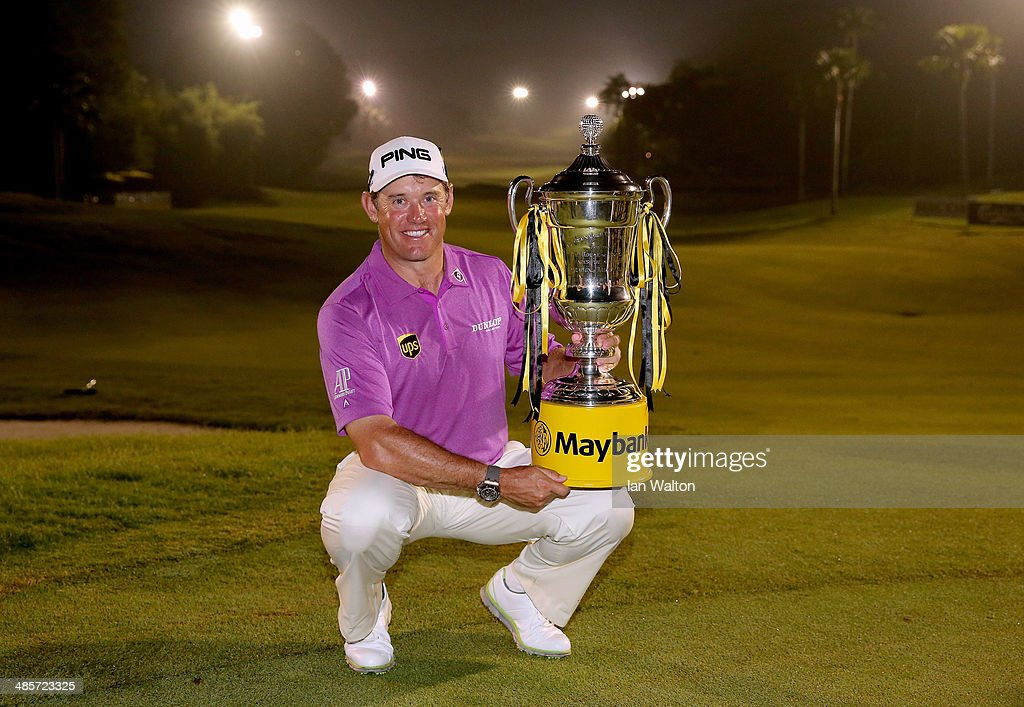 Lee Westwood of England celebrates with the trophy after winning the Final round of the 2014 Maybank Malaysian Open at Kuala Lumpur Golf & Country Club on April 20, 2014 in Kuala Lumpur, Malaysia.