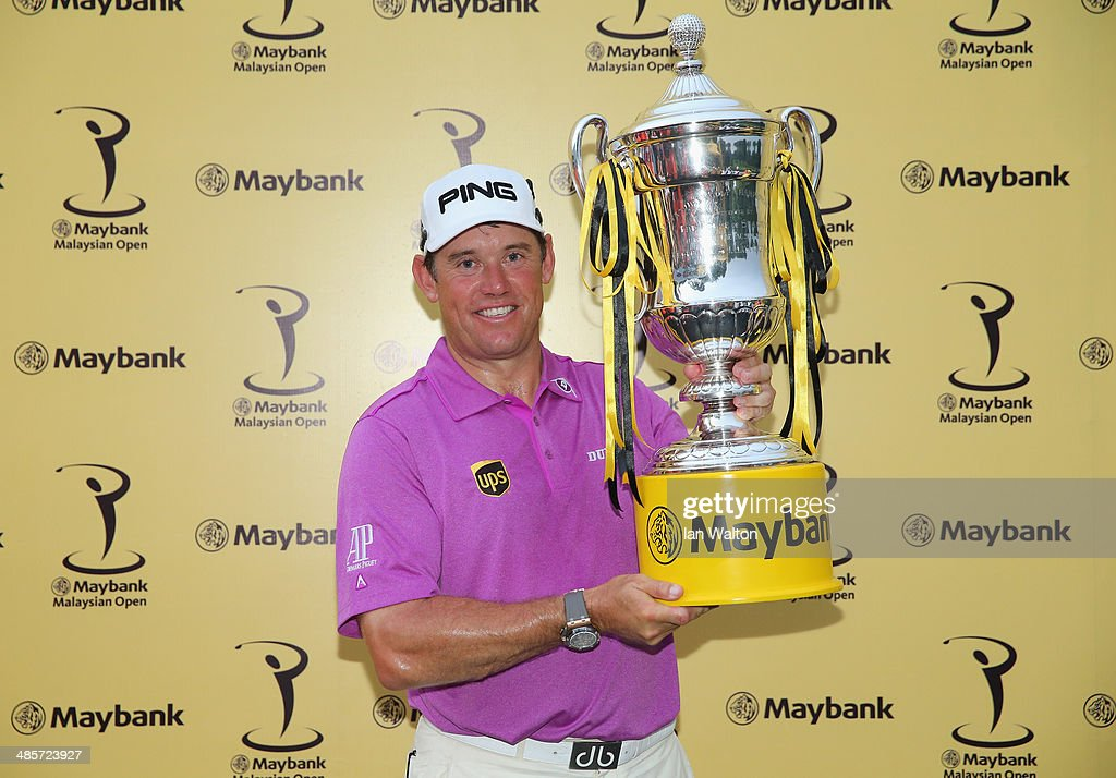 <a gi-track='captionPersonalityLinkClicked' href=/galleries/search?phrase=Lee+Westwood&family=editorial&specificpeople=171611 ng-click='$event.stopPropagation()'>Lee Westwood</a> of England celebrates with the trophy after winning the Final round of the 2014 Maybank Malaysian Open at Kuala Lumpur Golf & Country Club on April 20, 2014 in Kuala Lumpur, Malaysia.