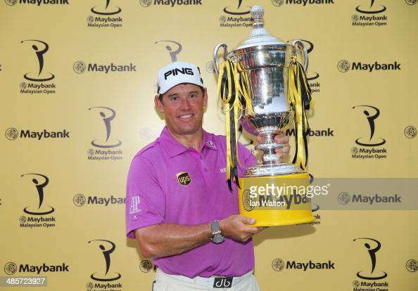 Lee Westwood of England celebrates with the trophy after winning the Final round of the 2014 Maybank Malaysian Open at Kuala Lumpur Golf Country Club...