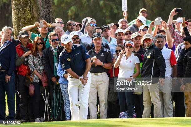 Lee Westwood of England chips a shot as fans watch on the 16th hole green during the final round of the World Golf ChampionshipsMexico Championship...