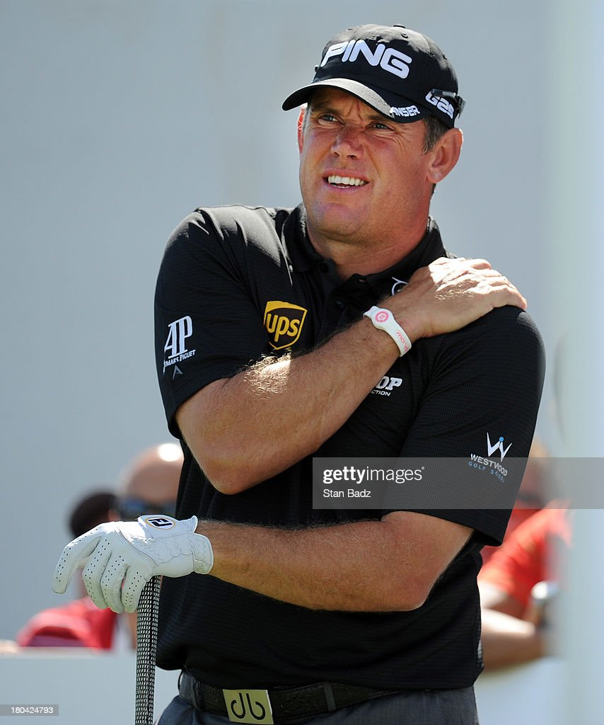 Lee Westwood of England grabs his left shoulder after hitting a drive on the 18th hole during the first round of the BMW Championship at Conway Farms Golf Club on September 12, 2013 in Lake Forest, Illinois.