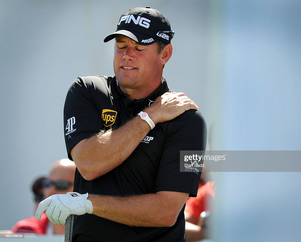 <a gi-track='captionPersonalityLinkClicked' href=/galleries/search?phrase=Lee+Westwood&family=editorial&specificpeople=171611 ng-click='$event.stopPropagation()'>Lee Westwood</a> of England grabs his left shoulder after hitting a drive on the 18th hole during the first round of the BMW Championship at Conway Farms Golf Club on September 12, 2013 in Lake Forest, Illinois.