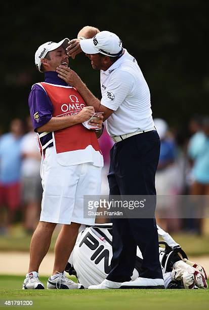 Lee Westwood of England has a bit of fun with his caddie Billy Foster during the second round of the Omega European Masters at CranssurSierre Golf...