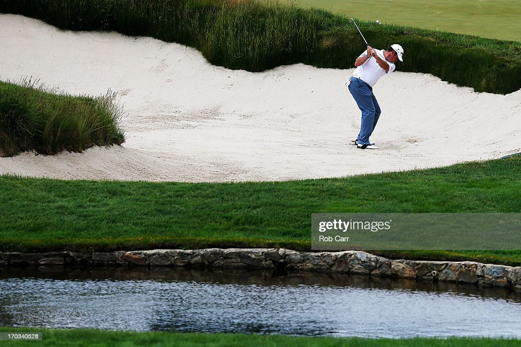 Lee Westwood of England hits a shot from a bunker during a practice round prior to the start of the 113th U.S. Open at Merion Golf Club on June 11, 2013 in Ardmore, Pennsylvania.