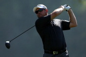 Lee Westwood of England hits a tee shot on the 4th hole in the first round of the Northern Trust Open at the Riviera Country Club on February 13 2014...