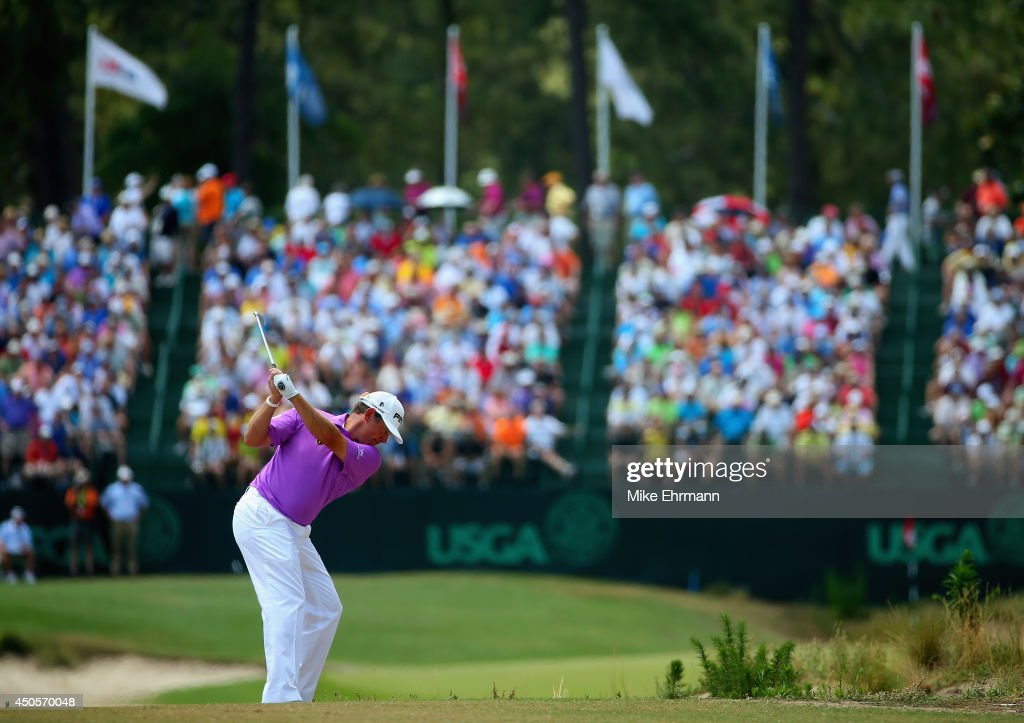 Lee Westwood of England hits an approach shot on the 16th hole during the second round of the 114th U.S. Open at Pinehurst Resort & Country Club, Course No. 2 on June 13, 2014 in Pinehurst, North Carolina.