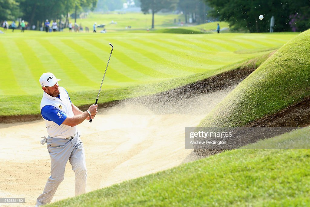 <a gi-track='captionPersonalityLinkClicked' href=/galleries/search?phrase=Lee+Westwood&family=editorial&specificpeople=171611 ng-click='$event.stopPropagation()'>Lee Westwood</a> of England hits from a bunker on the 16th hole during day four of the BMW PGA Championship at Wentworth on May 29, 2016 in Virginia Water, England.