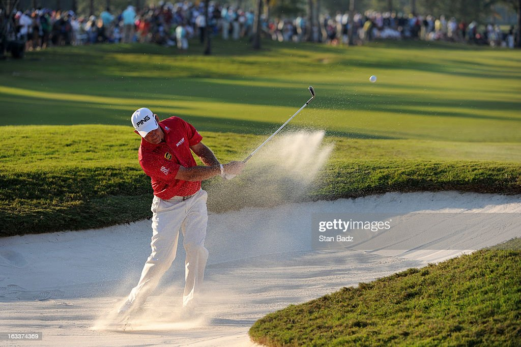 Lee Westwood of England hits from a bunker on the 18th hole during the second round of the World Golf Championships-Cadillac Championship at TPC Blue Monster at Doral on March 8, 2013 in Doral, Florida.