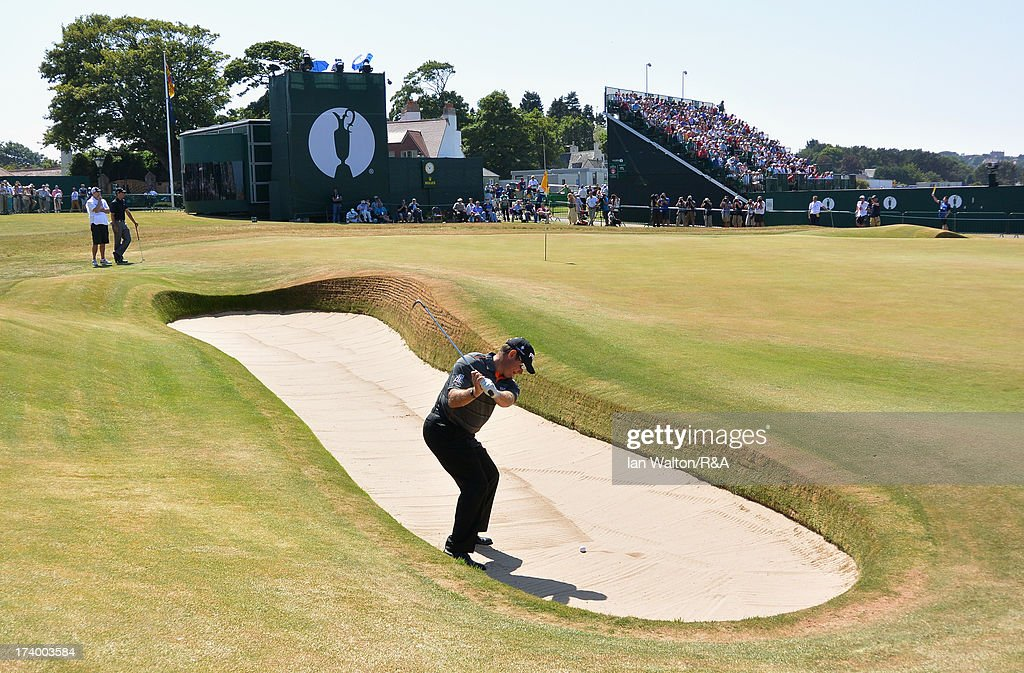 Lee Westwood of England hits from a greenside bunker on the 18th hole during the second round of the 142nd Open Championship at Muirfield on July 19, 2013 in Gullane, Scotland.