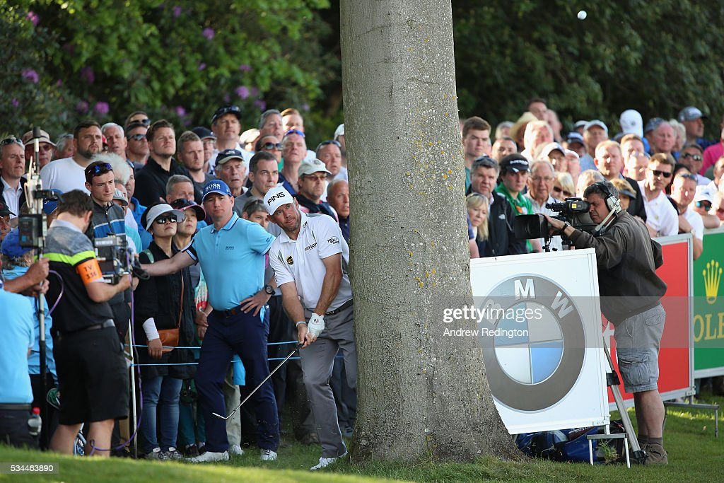 <a gi-track='captionPersonalityLinkClicked' href=/galleries/search?phrase=Lee+Westwood&family=editorial&specificpeople=171611 ng-click='$event.stopPropagation()'>Lee Westwood</a> of England hits from behind a tree on the 18th hole during day one of the BMW PGA Championship at Wentworth on May 26, 2016 in Virginia Water, England.