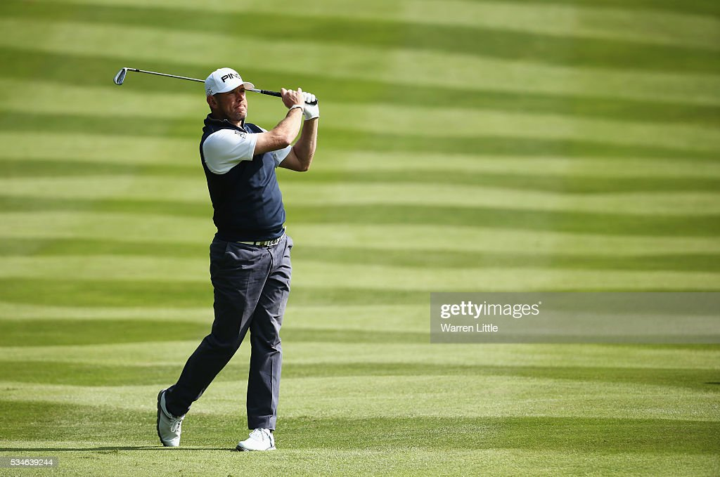 Lee Westwood of England hits his 2nd shot on the 4th hole during day two of the BMW PGA Championship at Wentworth on May 27, 2016 in Virginia Water, England.