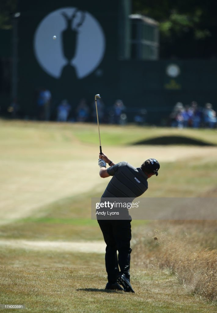 Lee Westwood of England hits his approach shot on the 18th during the second round of the 142nd Open Championship at Muirfield on July 19, 2013 in Gullane, Scotland.