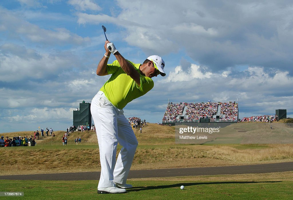 Lee Westwood of England hits his tee shot on the 13th hole during the first round of the 142nd Open Championship at Muirfield on July 18, 2013 in Gullane, Scotland.