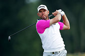 Lee Westwood of England hits his tee shot on the eighth hole during the continuation of the weather delayed first round of the US Open at Oakmont...