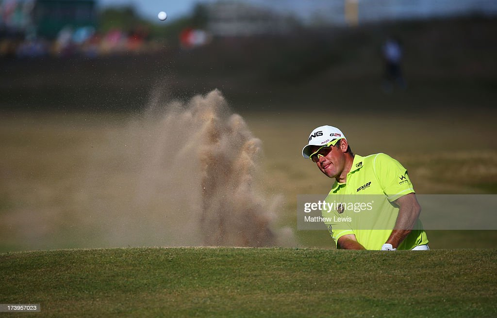 Lee Westwood of England hits out of a bunker on the 15th hole during the first round of the 142nd Open Championship at Muirfield on July 18, 2013 in Gullane, Scotland.