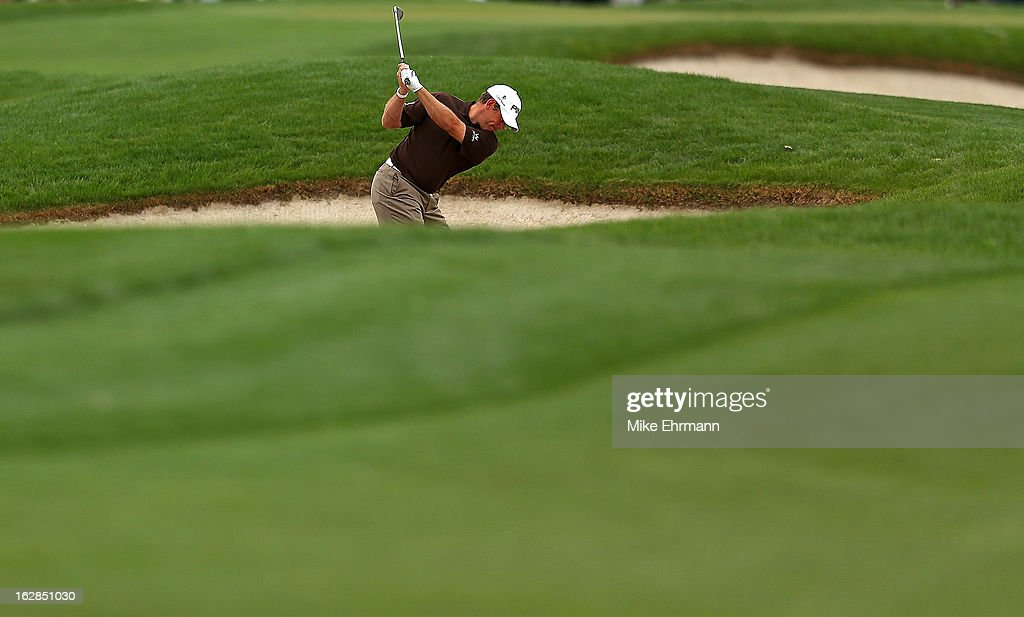 Lee Westwood of England hits out of the fairway bunker on the third hole during the first round of the Honda Classic at PGA National Resort and Spa on February 28, 2013 in Palm Beach Gardens, Florida.