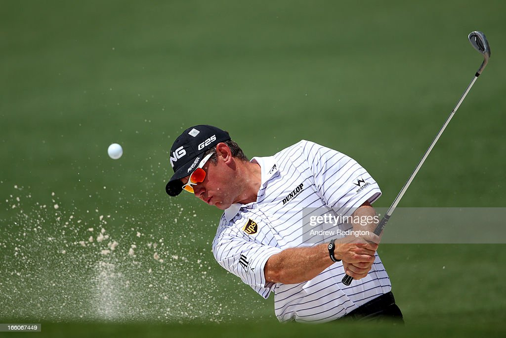 Lee Westwood of England hits out the bunker during a practice round prior to the start of the 2013 Masters Tournament at Augusta National Golf Club on April 8, 2013 in Augusta, Georgia.