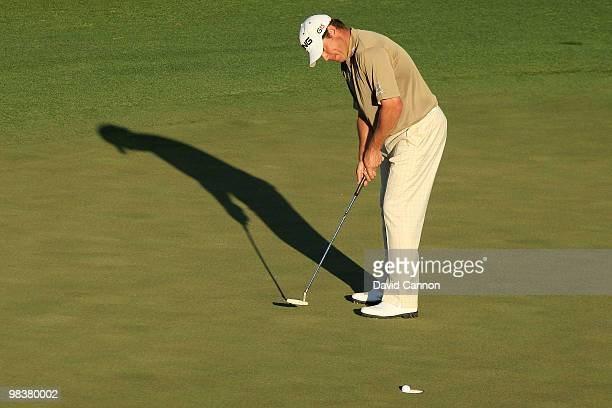 Lee Westwood of England holes a par putt on the 18th green during the third round of the 2010 Masters Tournament at Augusta National Golf Club on...