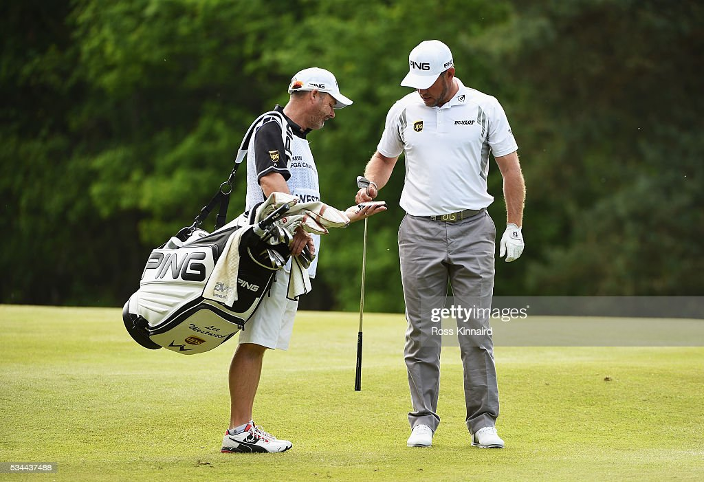<a gi-track='captionPersonalityLinkClicked' href=/galleries/search?phrase=Lee+Westwood&family=editorial&specificpeople=171611 ng-click='$event.stopPropagation()'>Lee Westwood</a> of England is handed a chocolate bar by caddie <a gi-track='captionPersonalityLinkClicked' href=/galleries/search?phrase=Billy+Foster+-+Caddy+de+golfe&family=editorial&specificpeople=12673088 ng-click='$event.stopPropagation()'>Billy Foster</a> during day one of the BMW PGA Championship at Wentworth on May 26, 2016 in Virginia Water, England.